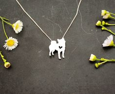 """This tiny Shiba Inu necklace is a perfectly delicate way to keep a loved pet close to your heart. Just ⅝"""" at its largest dimension, our pendants are made by hand with love.  This pendant is cut, soldered, finished, and polished completely by hand. It comes with a delicate sterling silver box chain, and is packaged in a gift box. If you are purchasing this item as a gift and would like a short note included, please add your text in the note to seller at checkout…"""