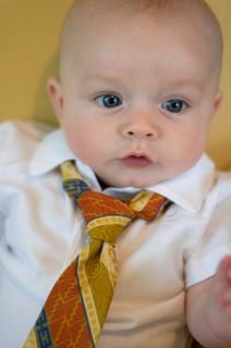 I got a thrift store tie and used the skinny end. Tied it and cut it off. Stitched it closed and sewed it on his onesie. He looks so cute at church.