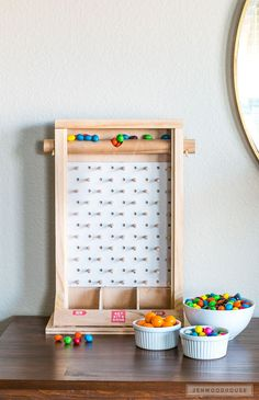 Learn how to make a DIY candy dispenser plinko game - so fun! Fill it with your favorite sweet treats and make a game out of it!
