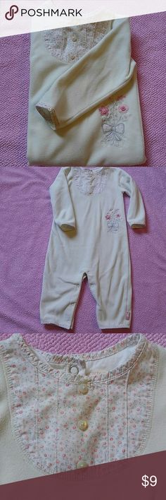 Fleece one piece Carter's Super Cute collection fleece button up one piece. Cream colored fleece with pink and grey floral pattern details. Size 18 months and in great condition. Perfect to keep your little girl warm, comfortable and functionable. One Pieces Bodysuits