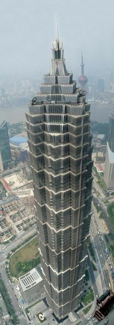 Jin Mao Building, was developed in 1999 in Shanghai, China. The tower has 88 floors and is 421 metres ft. It contains offices and the Shanghai Grand Hyatt hotel. Unusual Buildings, Interesting Buildings, Amazing Buildings, Modern Buildings, Famous Buildings, Futuristic Architecture, Beautiful Architecture, Art And Architecture, Building Structure