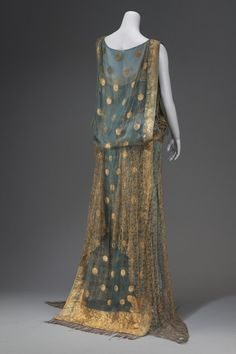 Made in part from an Indian sari of blue and gold; straight cut; blue satin slip; front of bodice and back, including short train, of sari; skirt of dress and underarm panels of gold lace; worn by Mrs. John D. Rockefeller, Jr.