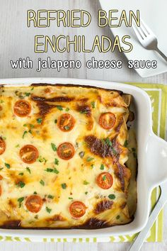 Vegetarian refried bean enchiladas with a creamy jalapeno cheese sauce - the best enchiladas ever!