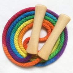 Hand-dyed jump rope, rainbow colored with wooden handles
