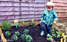 Put some new plants into our Toddler Garden.