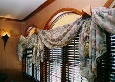 Details..... Drapery system using copper fence post caps with closet pole extensions....