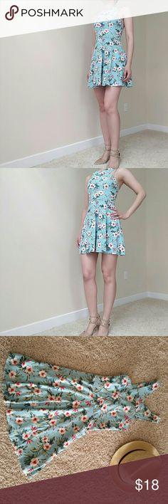 Floral cross front halter dress One of a kind. Cross front halter neck. Hollister Dresses Mini
