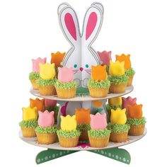 Tulip cookies on cupcakes with bunny cupcake stand Wilton Cupcakes, Egg Cupcakes, Spring Cupcakes, Mini Cupcakes, Themed Cupcakes, Easter Bunny Cupcakes, Easter Bunny Eggs, Easter Treats, Hoppy Easter