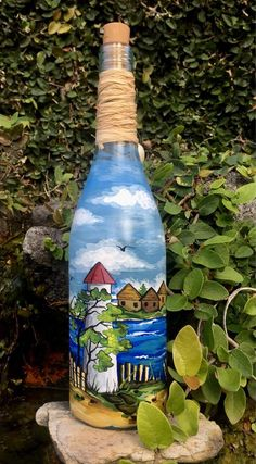 """Figure out more details on """"patio decor"""". Check out our web site. Painted Milk Cans, Painted Glass Bottles, Recycled Glass Bottles, Glass Bottle Crafts, Wine Bottle Art, Lighted Wine Bottles, Painted Wine Glasses, Bottle Lights, Decorated Bottles"""