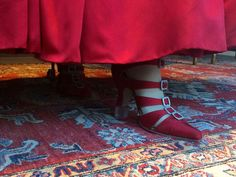 Claire's red silk shoes with silver buckles