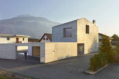 savioz fabrizzi architectes sets gabled concrete dwelling beneath alpine peaks