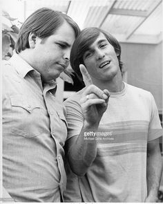 Guitarist Carl Wilson and drummer Dennis Wilson of the rock and roll band 'The Beach Boys' pose for a portrait in circa 1966.