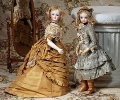 """BISQUE POUPEE BY JUMEAU IN ORIGINAL COSTUME. Marks: 2. 15 ½"""". Bisque swivel head on bisque shoulderplate, almond-shaped blue paperweight eyes,"""