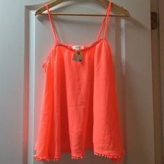 Fun crop-ish top! Neon orange-pink tank top with hanging ball details at edge. Mid- drift-ish. With tags and never worn! Umgee Tops Tank Tops