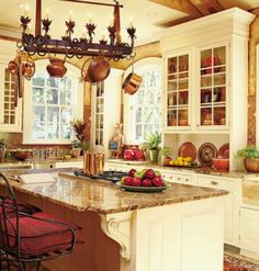 French country kitchen with copper pans. Get the look here: http://www.copperproper.com/copperdecor.html