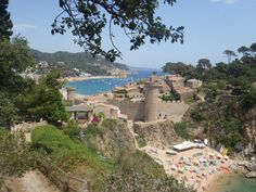 Tossa De Mar, an unexpected piece of prettiness on the Costa Brava. Higgledy piggledy castle walls shielding beautiful balancing homes across the hills Castle Wall, Places Ive Been, Costa, Dolores Park, Barcelona, Around The Worlds, Walls, Journey, Real Estate
