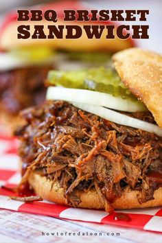 A close-up view of a slow-cooker BBQ brisket sandwich with a sliced onion and pickles on a checkered cloth. Brisket Sandwich Recipe, Hot Sandwich Recipes, Bbq Sandwich, Sandwiches, Panini Recipes, Beef Brisket Crock Pot, Beef Brisket Recipes, Bbq Brisket, Beef Steak