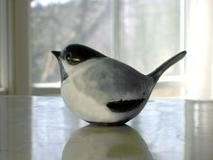 Stoneware Chickadee Sculpture on a soft gray day M.jpg 700×525 pixels
