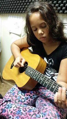 Maya and her guitar