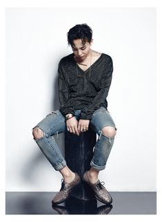 Sporting trendy ripped denim jeans, G-Dragon mixes casual and formal elements, showcasing his Giuseppe Zanotti dress shoes.