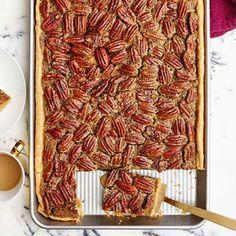 Pecan slab pie is all the things you love about pecan pie (the sweetness of brown sugar with the crunch from the pecans), but this pie can feed your dessert-loving Thanksgiving crowd. 13 Desserts, Desserts For A Crowd, Cooking For A Crowd, Holiday Desserts, Holiday Recipes, Baking Desserts, Holiday Baking, Pecan Pie Bars, Toffee Bars
