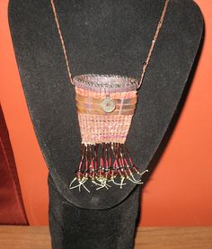 Amulet pouch necklace made from waxed linen, bugle & other beads, raffia, copper strips and I ching coin.