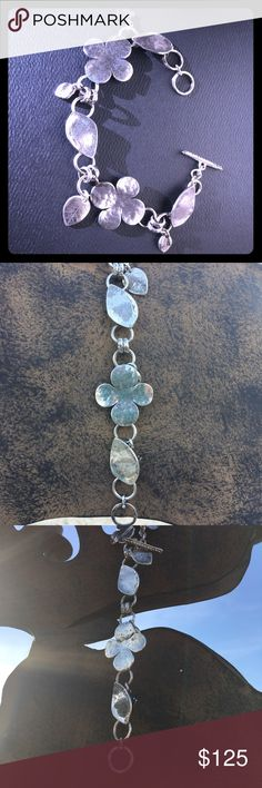 RETIRED SILPADA STERLING SILVER CLOVER BRACELET This is a stunning light weight .925 sterling silver Silpada 4 leaf clover bracelet.  Fits up to 7 & 3/4 inch wrist.  This is a great piece to wear everyday or out in the town.  If your a Silpada lover this is a rare find and a must have for your collection Silpada Jewelry Bracelets