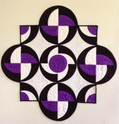 I saw the pattern for this quilt (Rythmic by Sew Karen-ly Created) and was so taken by its contrast of colors and use of circles and angles. Mini Quilts, Quilting Projects, Quilting Designs, Circle Quilt Patterns, Drunkards Path Quilt, Colorful Rangoli Designs, Purple Quilts, Art Textile, Quilt Festival