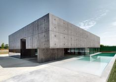 house in urgnano reframes the horizon with concrete