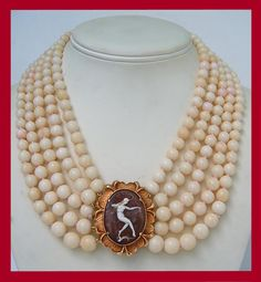 Antique coral necklace with a cameo of Josephine Baker. From the Talya D Collection.