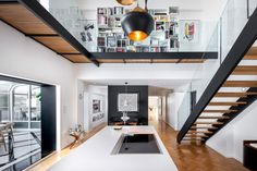 Peart/Weisgerber Residence at Habitat 67 by Moshe Safdie renovated by EMarchitecture Kitchen and Second Landing