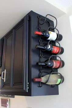Wine rack on side of cabinet nice way to use space, brilliant for saving space