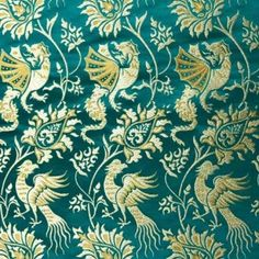 Brocade with Basilisks, Turquoise This fabric is a replica of a 14th century fabric from a dalmatic in Halberstadt, Germany, mentioned in Otto von Falke's book Decorative Silks. The fabric was woven in Italy but the designs shows Chinese influence, as was typical for many European fabrics of this period. The fabric shows birds and bazilisks, a European modification of Chinese dragons.