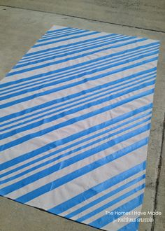 Make a painted canvas floor cloth from a drop cloth for a fun outdoor accent. Drop Cloth Rug, Canvas Drop Cloths, Floor Cloth, Painted Rug, Painted Canvas, Painted Floors, Picnic Blanket, Outdoor Blanket, Custom Slipcovers