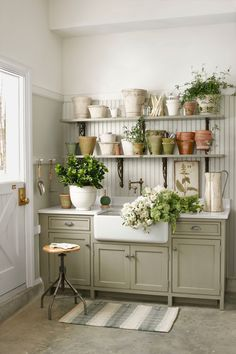Glam up your backyard workspace by adding plenty of surfaces for cutting flowers and a sink for washing muddy hands. You can also utilize the walls to hang brooms, rakes, or other gardening tools.   - HouseBeautiful.com