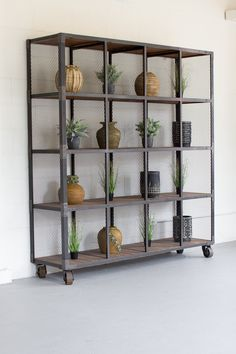 The Kalalou Raw Metal And Recycled Honey Wood 16 Cube Display Unit is an extremely spacious and elegant Display Unit. This Display Unit from Kalalou comes with Industrial Chic, Industrial Furniture, Industrial Living, Industrial Design, Rolling Shelves, Metal Shelves, Farmhouse Furniture, Rustic Furniture, Car Furniture