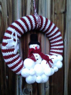 Krans met sneeuwpop en schaatsen. Het patroon kan je vinden op mijn groep. Creatief Groep Disco fb https://www.facebook.com/groups/207966226068790/