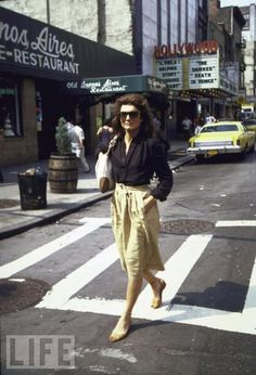 "Jackie Kennedy Onassis crosses a street in 1981. She died in 1994 at age 64. ""My mother died surrounded by her friends and her family and her books, and the people and the things that she loved. She did it in her own way, and on her own terms, and we all feel lucky for that,"" John Jr. said."