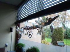 decoratie takken voor het raam