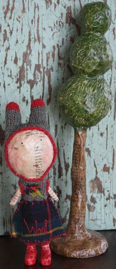 …this one of a kind papier mache figure is ladened with British artist Julie Arkell's signature style, available at  http://www.earthangelsstudios.com/Julie-Arkell-C44.aspx