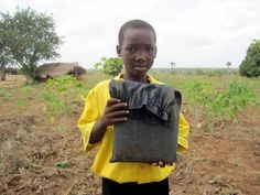 A boy in Ghana shows his beloved backpack.