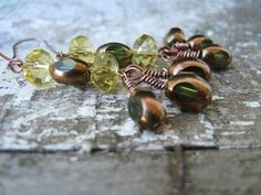 Beautiful Earrings using yellow Swarovsky Crystals and clear green glass beads with flat surfaces and copper tone coating.   These earrings are on Copper Wires and are hand wrapped.     Earrings measure 1 5/8 inch and wires are 1 inch long  Metric is  4cm and wires are 2.5cm
