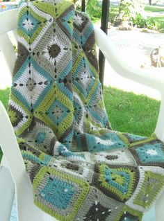 Granny Square Blanket. I cannot knit or crochet, but I love these colors and it would be fun to learn.