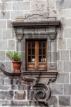 Beautiful window with lovely architectural detailing.
