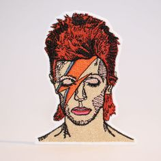 David Bowie Patch by mimosch. Mimosch patches are a fun and simple way to personalise your t-shirts, jackets, hats, jeans, canvas bags, & canvas sneakers and much more! All patches are designed by myself and handcrafted with great care. They feature an iron-on backing & ship with instructions. How to apply the patch 1. Important note: Always iron without steam. 2. Thoroughly iron the area of the garment where the patch will be placed. 3. Place the patch on the garment and put a clot...