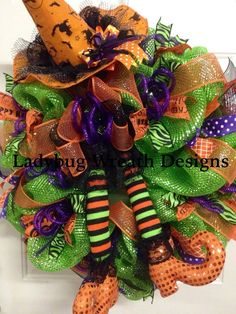 READY FOR TRICK OR TREATERS-This wreath is bright and colorfully done in metallic lime green deco mesh, with contrasting ribbons in purple,