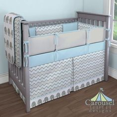 Elephants and Chevron:  Crib bedding in Solid Mist, Mist and Gray Chevron, White and Gray Elephants, Solid Silver Gray. Created using the Nursery Designer® by Carousel Designs where you mix and match from hundreds of fabrics to create your own unique baby bedding.