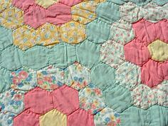 Vintage grandmother's flower garden quilt by Mama, via Flickr