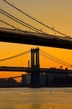 NYC. Manhattan & Brooklyn Bridges at dusk
