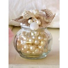 using pearls in your arrangements would be sooo cute with lace and what not. Only for small arrangements or ones with a Styrofoam filler.